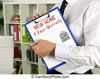 Business concept about NEW HOME 1 Year Warranty with inscription on the sheet.
