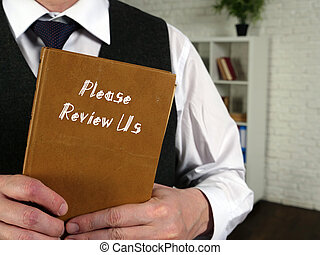 Business concept about Please Review Us with sign on the piece of paper.