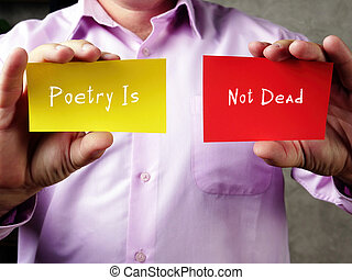 Business concept about Poetry Is Not Dead with sign on the sheet.