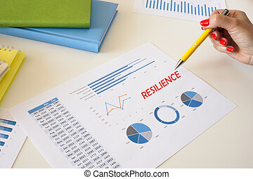Business concept about RESILIENCE with inscription on the sheet.