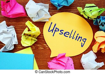 Business concept about Upselling with sign on the piece of paper.