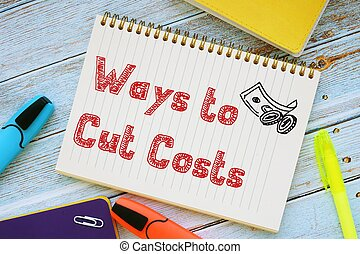 Business concept about Ways To Cut Costs with phrase on the piece of paper.