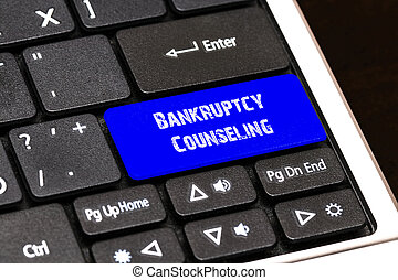 Business Concept - Blue Bankruptcy Counseling Button on Slim...