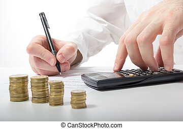 Business concept. Businessman's hand counting money on calculato