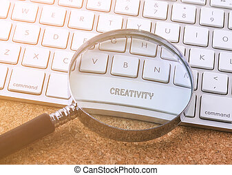 Business concept: CREATIVITY on computer keyboard background.