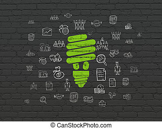 Business concept: Energy Saving Lamp on wall background