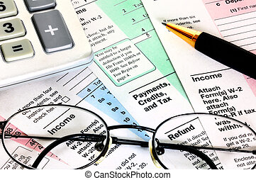 Business concept. Financial papers with calculator, glasses and pen.