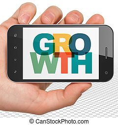 Business concept: Hand Holding Smartphone with Growth on  display