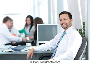 Business concept - handsome happy  business man in office.
