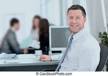 Business concept - handsome mature business man in office.