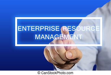 Business concept image of a businessman clicking Enterprise Resource Management button on virtual screen over blue background