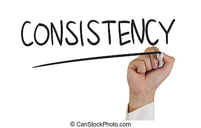 Consistency - Business concept image of a hand holding ...