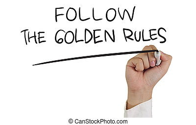 Business concept image of a hand holding marker and write Follow the Golden Rules words isolated on white