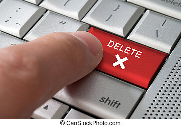 Business concept male finger pointing delete key on a...