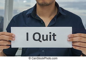 business concept - man hold paper of I quit in office for resignation