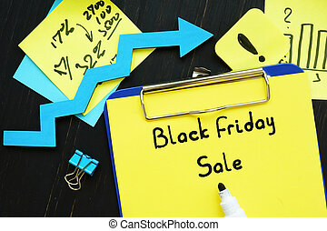 Business concept meaning Black Friday Sale with phrase on the sheet.