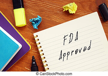Business concept meaning FDA Approved with inscription on the piece of paper.