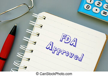 Business concept meaning FDA Approved with inscription on the sheet.