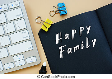 Business concept meaning Happy Family with phrase on the piece of paper.