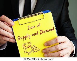 Business concept meaning Law of Supply and Demand with phrase on the piece of paper.