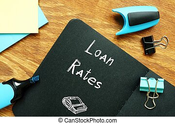 Business concept meaning Loan Rates with sign on the piece of paper.