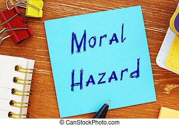 Business concept meaning Moral Hazard with inscription on the piece of paper.