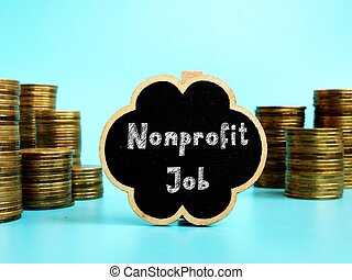 Business concept meaning Nonprofit Job with sign on the piece of paper.