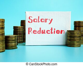 Business concept meaning Salary Reduction with sign on the piece of paper.