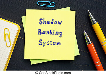 Business concept meaning Shadow Banking System with inscription on the piece of paper.