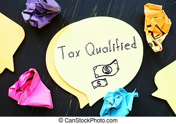 Business concept meaning Tax Qualified with sign on the piece of paper.