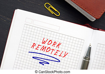 Business concept meaning WORK REMOTELY with inscription on the sheet. Remote work?is a?working?style that allows professionals to?work?outside of a traditional office environment