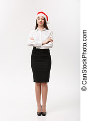 Business Concept - Modern caucasian business woman in christmas theme arm crossed posing on white studio background with copy space.