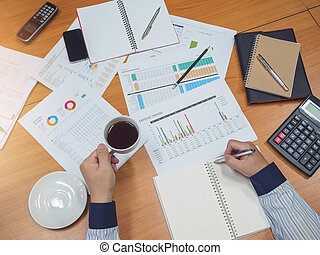 Business concept of office working, Young business man holding coffee cup with business background.