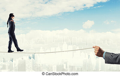 Business concept of risk support and assistance with man balancing on rope