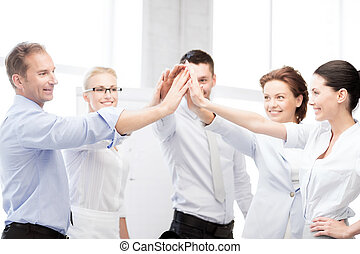 business team celebrating victory in office - business...
