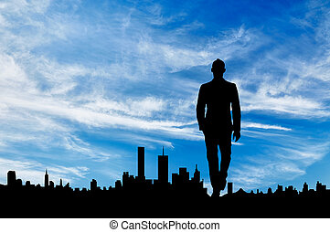 Silhouette of man on the background of the city