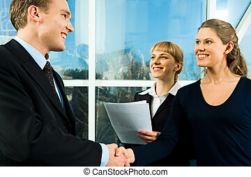 Business concept - Successful handshake of confident...