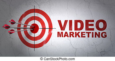 Business concept: target and Video Marketing on wall ...
