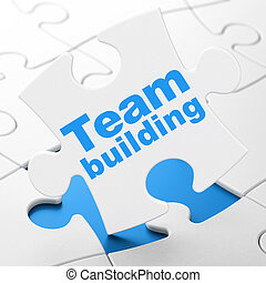 Business concept: Team Building on puzzle background