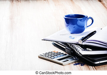 Business concept with agenda and coffee cup