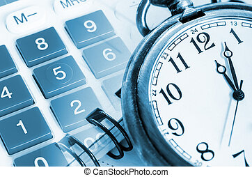 Business concept with clock and calculator.