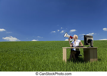 Business Concept Woman Using Megaphone In A Green Field
