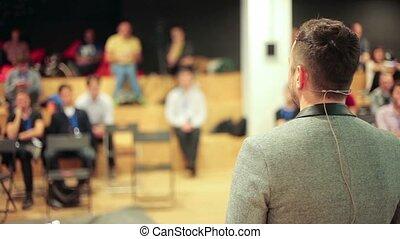 Caucasian speaker teaching at international conference