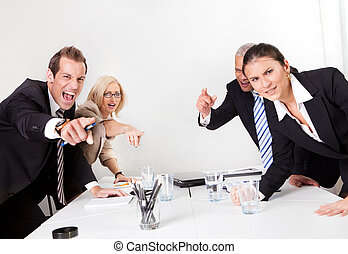 Business conflict - Four angry business people screaming at...
