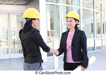 Business Construction Women Handshake - A pretty business...