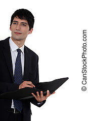 Business consultant holding a folder
