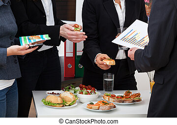 Business consultation during lunch - Business team on a...