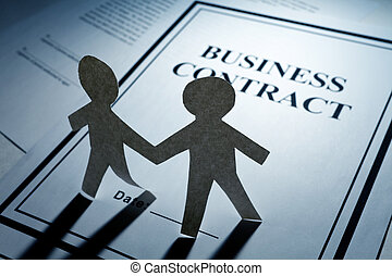 Business Contract and Paper Chain Men close up