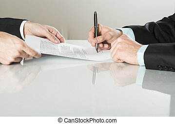 Business contract - Businessmen are signing a contract,...