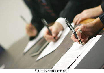 business contract - three hands holding pens signing ...